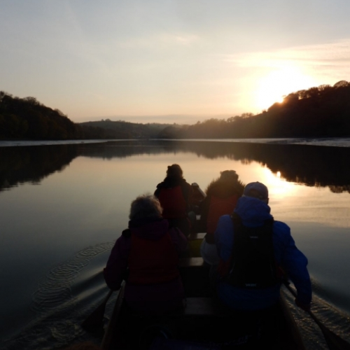 sunset on river dart devon with Canoe Adventures
