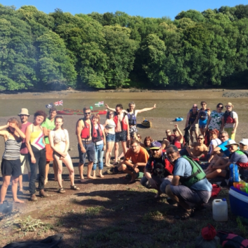 party on shore with Canoe Adventures