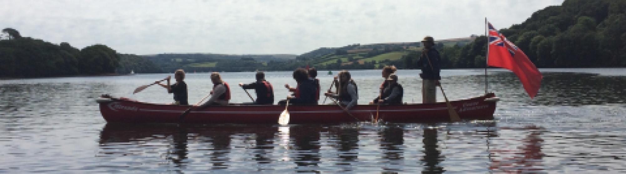 family canoeing with Canoe Adventures